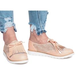 Roze opengewerkte loafers met Pamole-franjes