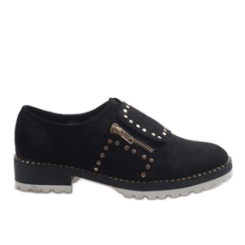 Zwarte slip-on brogues met studs U-6249