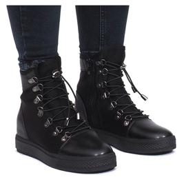 Zwarte opengewerkte sneakers van Mathilde wedge