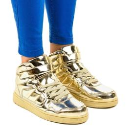 Goudgelakte sneakers XW7082 geel