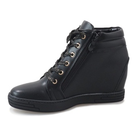 Zwarte sneakers met een gouden TL-22 schuifregelaar 2