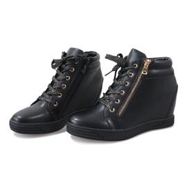 Zwarte sneakers met een gouden TL-22 schuifregelaar 3