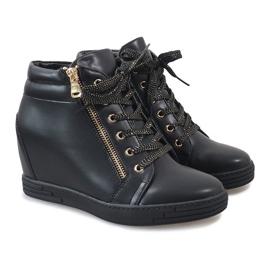 Zwarte sneakers met een gouden TL-22 schuifregelaar 4