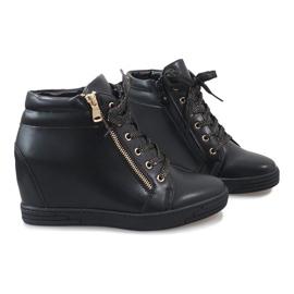 Zwarte sneakers met een gouden TL-22 schuifregelaar 5